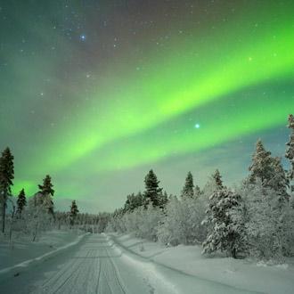 Winterlandschap met noorderlicht in Fins Lapland