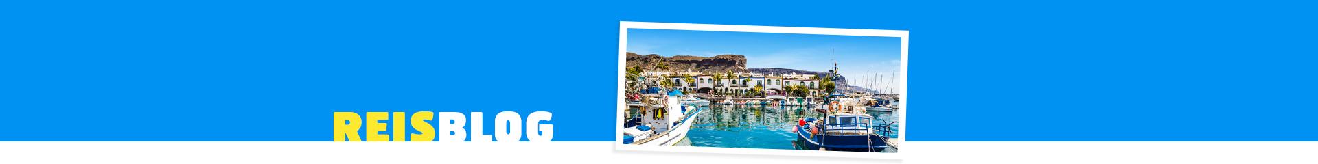 Uitzicht op de haven met bootjes op Gran Canaria