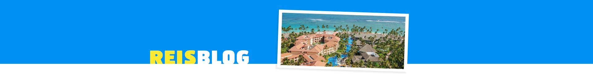 Hotel Majestic colanial Punta Cana, met vakantiehuizen in het groen en zee op de achtergrond